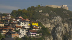 Houses and Bijela Tabija on a cliff in Sarajevo - stock footage
