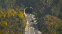 Beautiful view of cars driving towards a tunnel in Sarajevo - stock footage