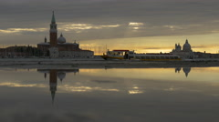 San Giorgio Maggiore Church and a boat reflecting in a puddle of water, Venice Stock Footage