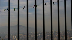 Clothes line seen through bars in Sarajevo Stock Footage