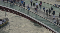 Close up view of people walking on Ponte della Constituzione in Venice Stock Footage