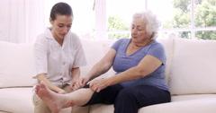 Nurse checking senior womans leg Stock Footage