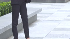 Elegant blonde business woman with tablet computer near office building Stock Footage