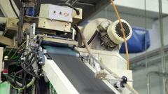 Pantyhose on the Conveyor Belt Stock Footage