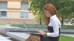 Student working on laptop computer on the terrace, cup of coffee. Close up Stock Footage