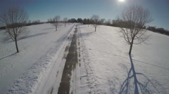 Aerial Snowy Driveway House Flyover to Reveal Snowy Fields. Stock Footage