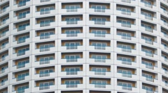 Curved Facade of an Unusual Urban Highrise Building. FullHD video Stock Footage