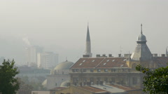 Cityscape of Sarajevo with minaret and domes - stock footage