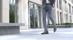 Human foot with brown leather shoes and jeans Stock Footage