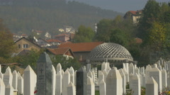 Tombstones and steel pavilion with cupola in a cemetery in Sarajevo Stock Footage