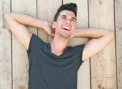 Portrait of a happy young male model laughing outdoors Stock Photos