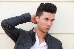 Attractive male fashion model with hand in hair - stock photo