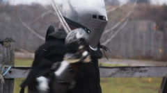 Actors in medieval warriors' suits training before historical fight reenactment Stock Footage