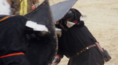 Fierce armed conflict between two mighty knights, medieval fight reenactment - stock footage