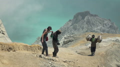 JAVA, INDONESIA - Tourist going down Ijen volcano crater, slow motio Stock Footage