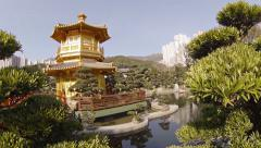Pagoda, Gardens and Pond of Chi Lin Nunnery in Hong Kong. FullHD video Stock Footage