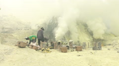 JAVA, INDONESIA - Ijen volcano crater, workers dig sulfur in extreme Stock Footage