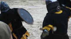 Fierce sword fight between two medieval soldiers, historical reenactment hobby - stock footage