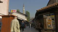 Street view of Gazi Husrev-beg Mosque minaret in Sarajevo Stock Footage