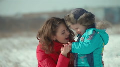A family. Mother with baby in winter snow. happiness and joy Stock Footage
