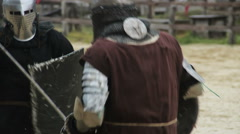 Fierce sword fight, two strong men showing their martial skills on battle field - stock footage