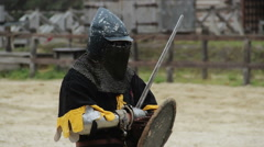 Brave warrior ready for fight with rival on battle field with sword and shield - stock footage