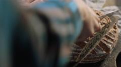 Cutting artisan sourdough bread Stock Footage