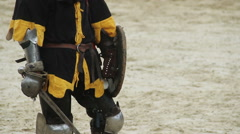 Mighty medieval knight wins fight, tournament rivals leaving battle field - stock footage