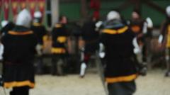 Defocused people in medieval suits preparing for historic fight reenactment Stock Footage