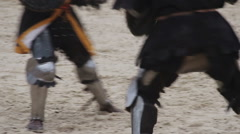 Two strong knights wearing steel armor fighting actively, medieval tournament - stock footage