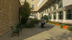 Alley with benches and plants next to a building in Sarajevo Stock Footage