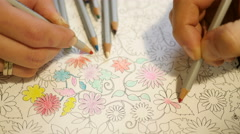 Couple drawing a pencil at home an Adult coloring book Stock Footage