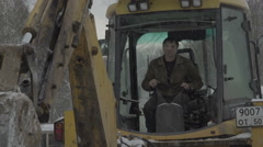 The man who controls the excavator drips Stock Footage