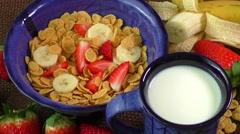 Healthy breakfast. Cornflakes, fresh strawberries, banana and milk Stock Footage