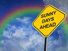Sunny Days Ahead Road Sign with a Rainbow in the Background Stock Illustration