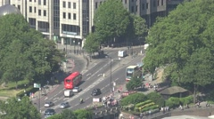4K Aerial view traffic street busy road London red bus people commute transport Stock Footage