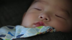 Close up of asian baby boy face sleeping peacefully Stock Footage