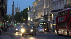 4K Traffic street crowded London town famous parliament tower red bus taxi cab  Stock Footage