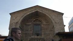 People walking in front of Gazi Husrev-begov bezistan in Sarajevo Stock Footage