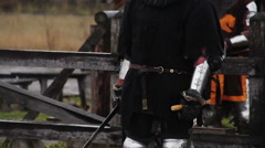 Brave warriors starting sword fight, reenactment of medieval knights tournament Stock Footage