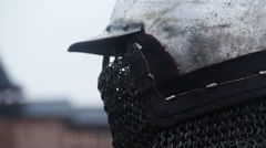 Close-up of medieval knight wearing steel helmet with chain mail face mask Stock Footage
