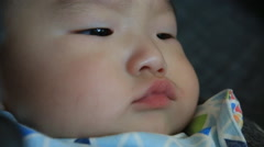 Close up of asian baby boy face unhappy and peevish Stock Footage