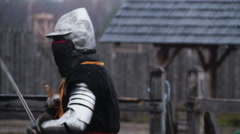 Mighty knight attacking rival with sword during tournament, medieval competition Stock Footage