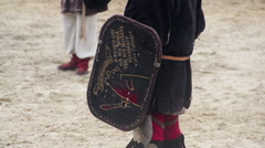 Children wearing historic suits reenacting knights' tournament at theme camp Stock Footage