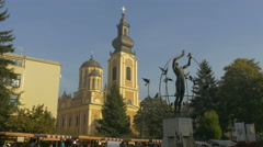 Street stalls in Liberation Square, next to a sculpture in Sarajevo Stock Footage