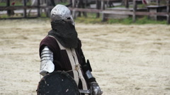 Brave knight tired after violent clash with rival, winner leaving battle field Stock Footage
