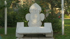 White sculpture with the coat of arms in a park, Sarajevo Stock Footage
