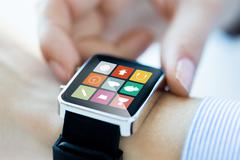 Close up of hands setting smart watch application Stock Photos