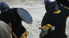 Fierce sword fight between two medieval soldiers, historical reenactment hobby Stock Footage