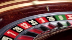 Roulette wheel running with white ball Stock Footage